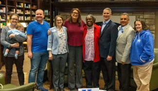 Reinette Jones (in red jacket) was honored with this year's Bourke-DeLeon Distinguished LGBTQ* Alumni Award on Monday.